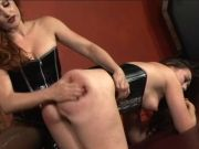 Sexy bdsm lesbos in corsets play with strapons and massagers in dungeon