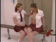 Two teenager bi-otches in college girl uniforms get their freak on in the locker room